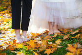 Bride and groom with bare foots — Stock Photo