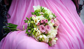 Bride holding a wedding bouquet — Stock Photo