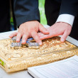 Hands on bible at a wedding ceremony — Stock Photo