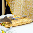 Wedding crowns and cross on a bible prepared for ceremony — Stock Photo