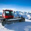 Stockfoto: Snow-grooming machine on snow hill