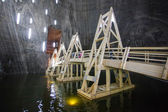 Underground wood bridge over lake in Turda Salt Mine — Stock Photo