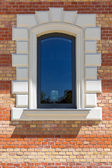 Window in a red brick wall — Stock Photo