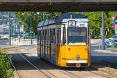 Yellow tram under Elisabeth Bridge in Budapest — Stock Photo