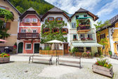 Colorful houses village square in Hallstatt — Stock Photo
