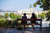 Two girls on a bench watching at Szechenyi Chain Bridge — Stock Photo