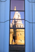 Windows reflection of Fisherman's Bastion lit by sunset — Stock Photo