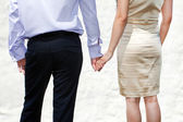 Young married couple holding hands — Stock Photo