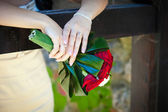 Bride holding a wedding bouquet — Stock Photo