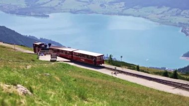 Diesel train railway carriage going to Schafberg Peak — Stock Video
