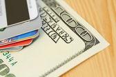 Credit card and 100 dollar close-up — Stock Photo