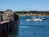 Wharf and fishing boats — Stock Photo
