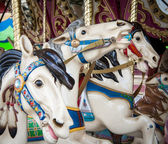 Colorful carousel horses — Stock Photo