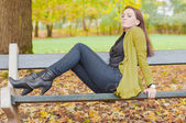 Beautiful women enjoy magic autumn — Stock Photo