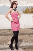 Beautiful woman in pink dress — Stok fotoğraf