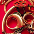 Stock Video: Gold chain and ring on red cloth