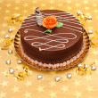 Chocolate cake on golden stars background — Stock Photo #13271729