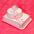 Christening cake for girl on pink background — Stock Photo #13271733