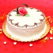 White cake on red background — Stock Photo #13828378