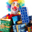 Happy clown with presents — Stock Photo