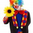 Clown with big yellow flower — Stock Photo