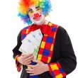 Clown showing big money — Stock Photo