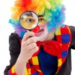 Clown with magnifying glass — Stockfoto