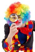 Clown with magnifying glass — Stock Photo