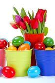 Painted Easter eggs and tulips — Stock Photo