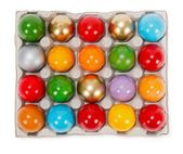Colorful painted Easter eggs in cardboard storage rack — Stock Photo