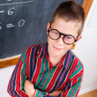 Smart schoolboy at chalkboard — 图库照片