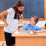 Teacher looking at pupil's homework — Stock Photo