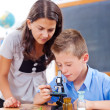 Schoolboy looking into microscope — Stock Photo #41315931