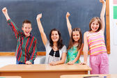 Teacher and pupils in classroom — Stock Photo