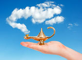Aladdin lamp in hand — Stock Photo