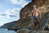 Bodybuilder at the beach — Stock Photo