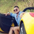 Back view of young driver. Open roof of cabrio car — Foto Stock