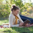 Using ipad young woman — Stock Photo