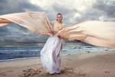 Model posing in extremely long dress — Stock Photo