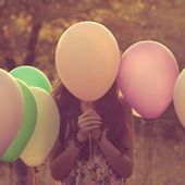 Girl and balloons — Stock Photo