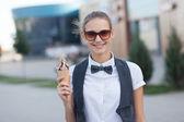 Girl eating ice cream outdoors — Stock Photo