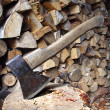 Old axe and firewood - Stock Photo