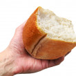 Hand with the half of bread — Stock Photo
