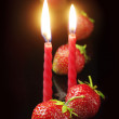 Strawberry and two candles — Stock Photo