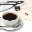 Cup of coffee and electrocardiogram  — Stock Photo