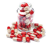 Glass bottle with capsule pills — Photo