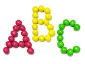 字母 a、 b 和 c 从糖果 — 图库照片