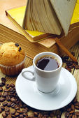 Cup of coffee and old books — Stock Photo