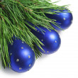 Blue Christmas toys and pine branch — Stock Photo #27413503