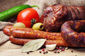 Smoked sausage, meat and vegetables — Stock Photo